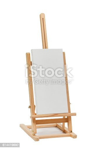 614417422 istock photo Wooden easel with blank canvas 614419692
