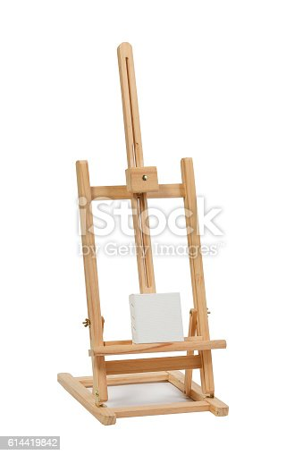 614417422 istock photo Wooden easel with blank canvas 614419842