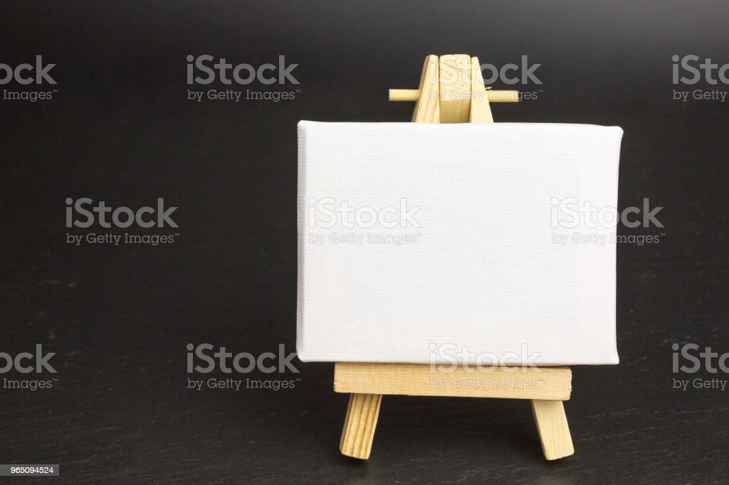 wooden easel with blank canvas zbiór zdjęć royalty-free