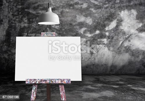 671393252 istock photo Wooden easel with blank painting canvas in the raw concrete room 671393196