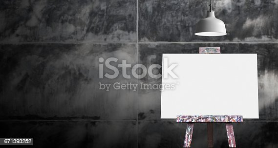 istock Wooden easel with blank painting canvas in the raw concrete room 671393252