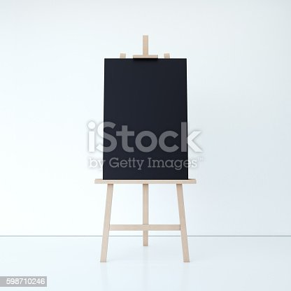 1021586250istockphoto Wooden easel with empty black canvas. 3d rendering 598710246
