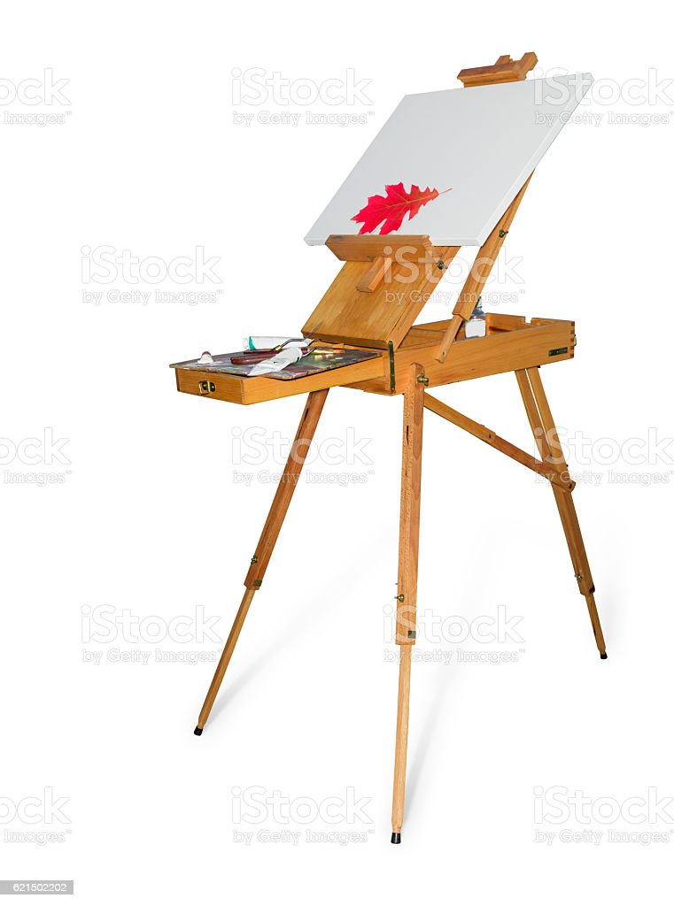 Wooden easel with empty canvas on a light background photo libre de droits