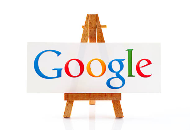 Wooden easel with word Google Tambov, Russian Federation - January 22, 2015: Wooden easel paper with word Google on it. White background. Word Google out of focus. Studio shot. google stock pictures, royalty-free photos & images
