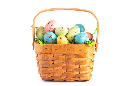 A Wooden Easter Basket Filled With Decorated Eggs Isolated On A White Background Stock Photo - Download Image Now