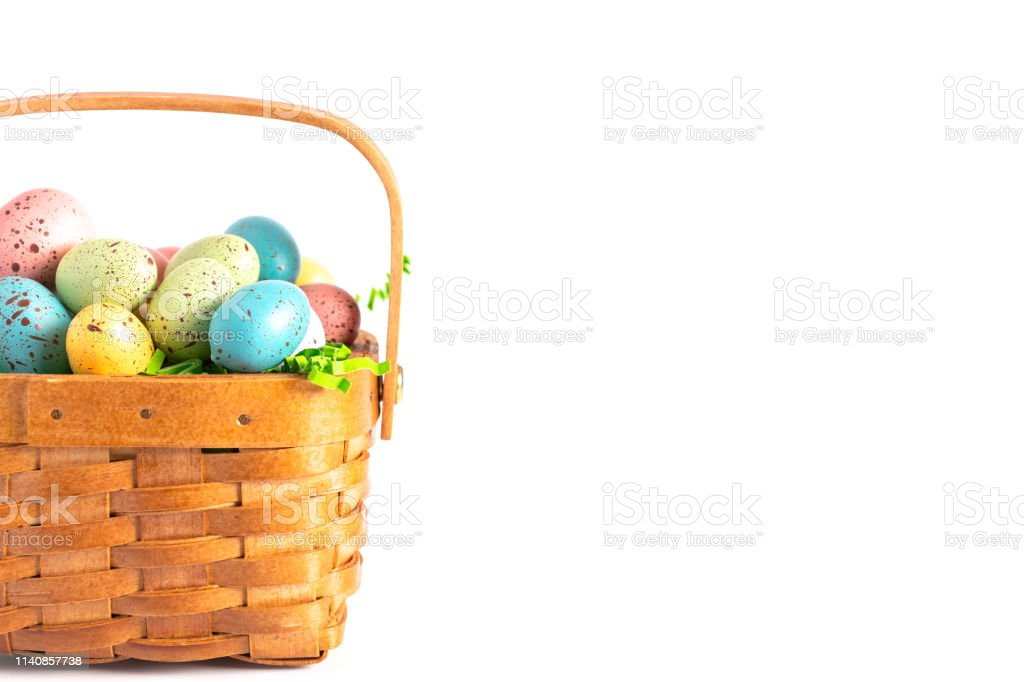 A Wooden Easter Basket Filled with Decorated Eggs Isolated on a White Background royalty-free stock photo