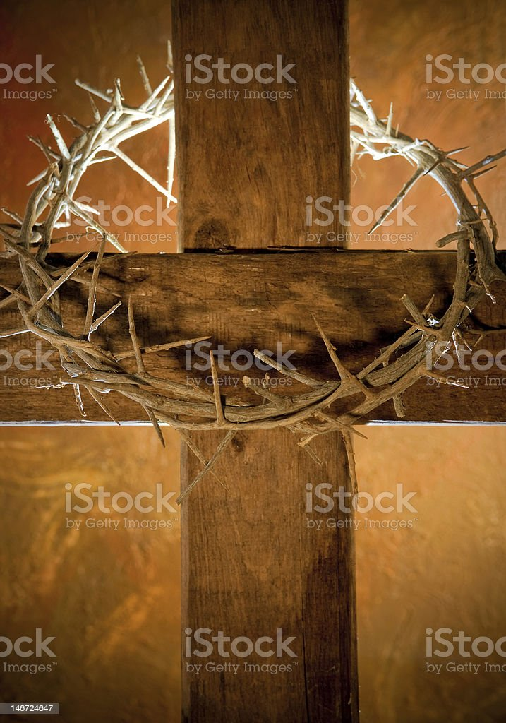 Wooden Easter cross with crown of thorns stock photo