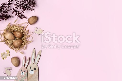 istock Wooden Easter eggs and Easter bunny decorations. 1216068298