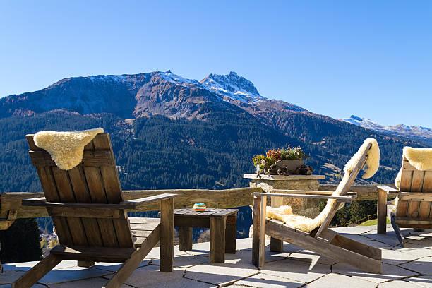 Wooden easy chairs at a mountain lodge terrace klosters switzer picture id513430976?b=1&k=6&m=513430976&s=612x612&w=0&h=sjk6tfs1yohegmlk oknfkjsbid8vcqx6lvieqligfw=