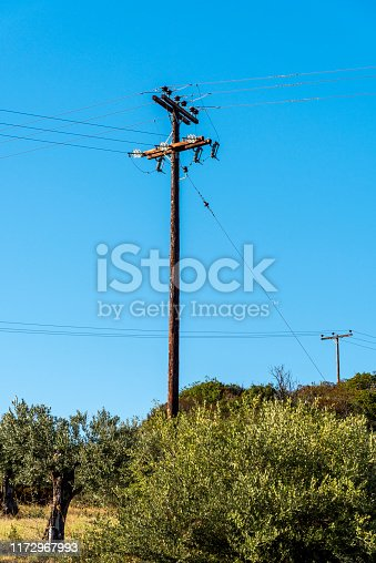 Wooden electric pole in nature, Greece.