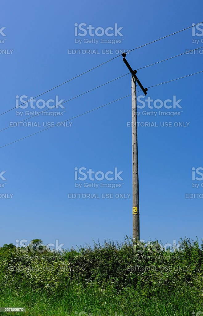Wooden electricity pole in a rural location stock photo