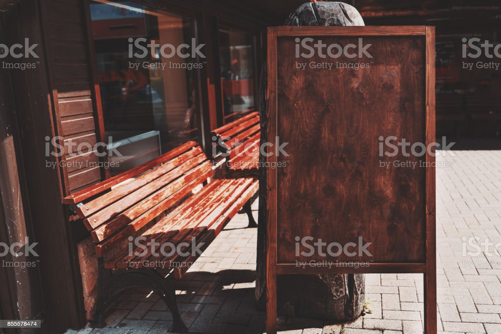Wooden empty banner placeholder on street stock photo