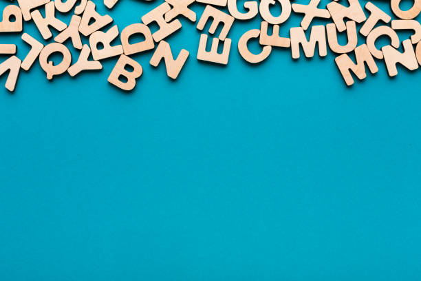 wooden english letters background - word game stock pictures, royalty-free photos & images