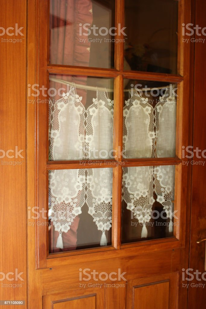 Wooden Entrance Door Small Window Lace Curtains Stock Photo Download Image Now Istock