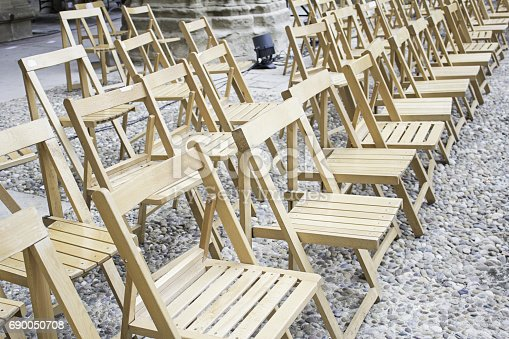 847512708 istock photo Wooden event chairs 690050708