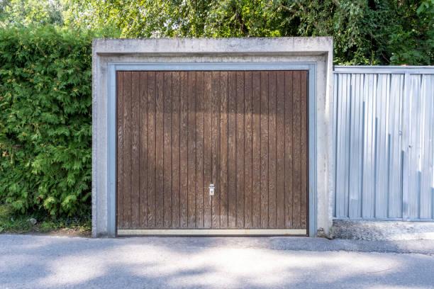 wooden exterior garage door of a property front view stock photo
