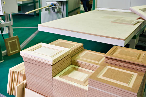 Wooden facades in furniture plant stock photo