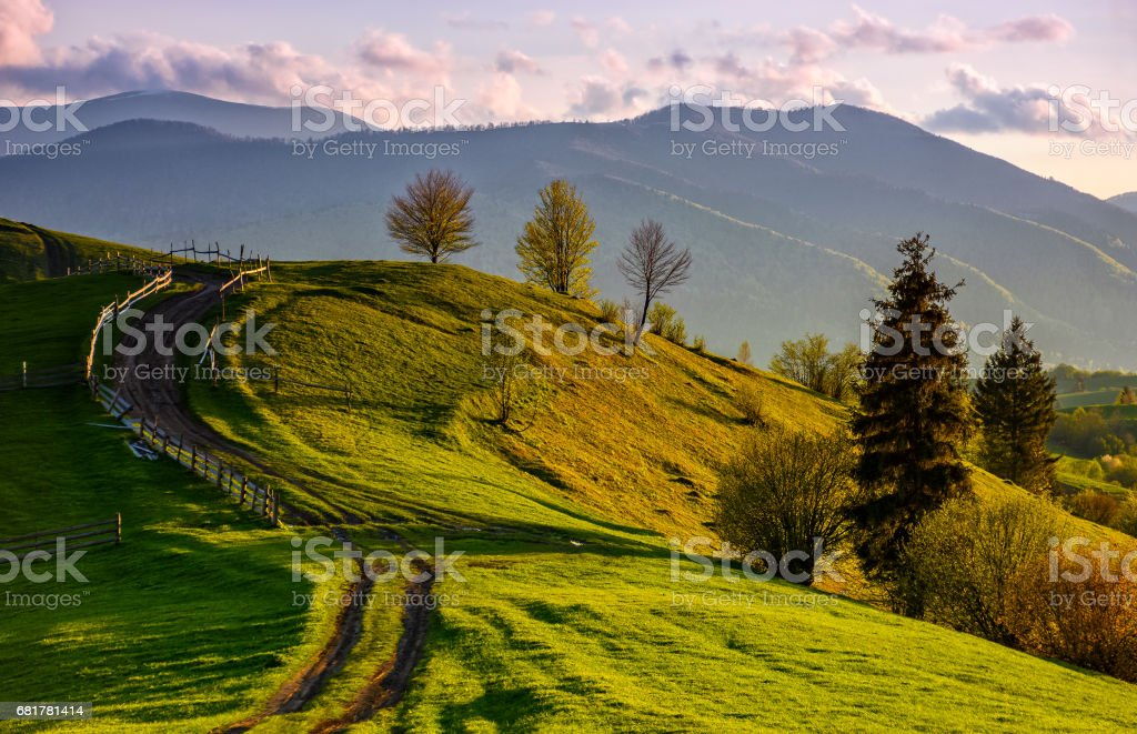 wooden fence along the path in mountains stock photo