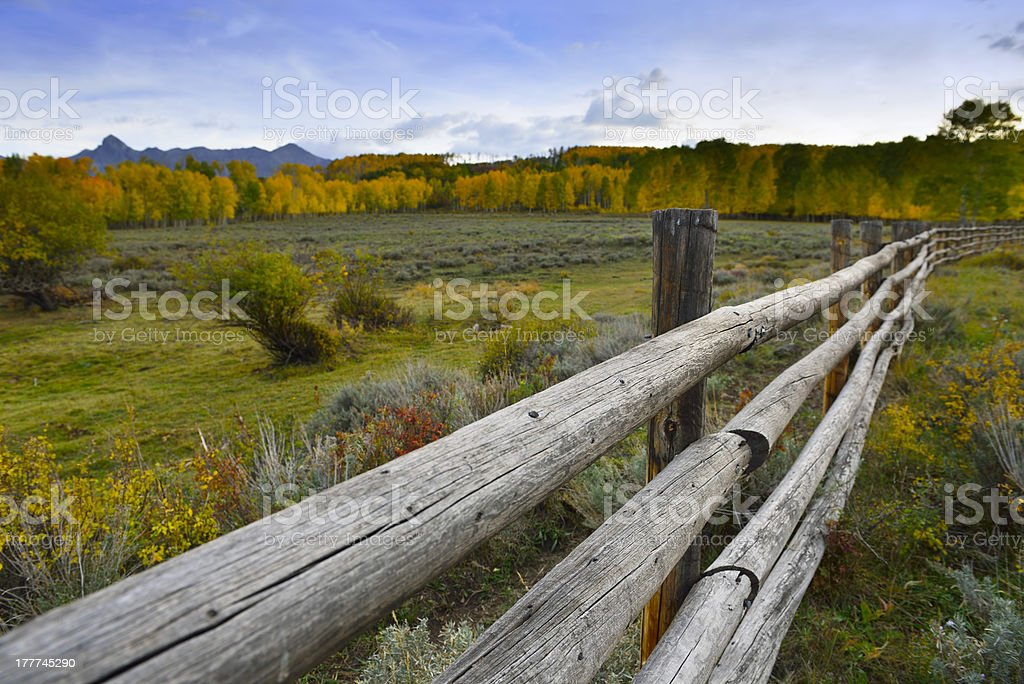 wooden fence along the road in colorado royalty-free stock photo
