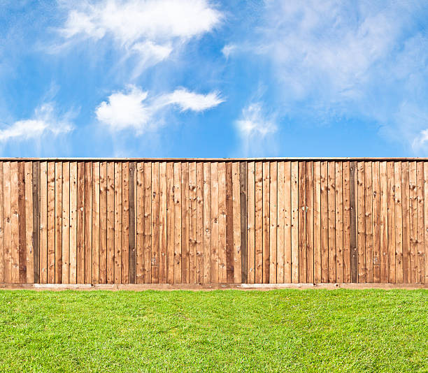 wooden fence at the grass - fence stock photos and pictures