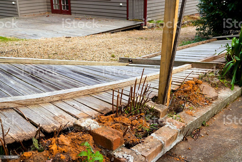 Wooden fence damaged by wind royalty-free stock photo
