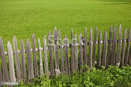 istock Wooden fence from a pasture in Val di Funes in Italy 1139340528
