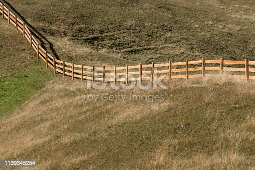 istock Wooden fence from a pasture in Val di Funes in Italy 1139345254