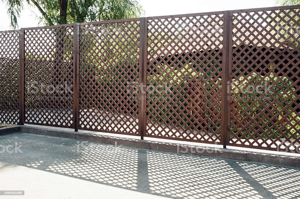 wooden fence in a grid in private house royalty-free stock photo