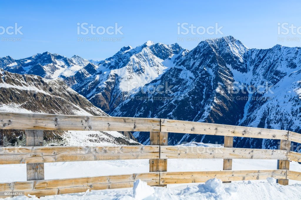 Wooden fence near on ski run in Riffelsee winter mountain resort, Pitztal valley, Austrian Alps stock photo