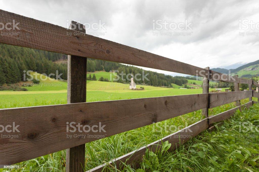 Wooden fence next to  an Italian mountain pasture stock photo