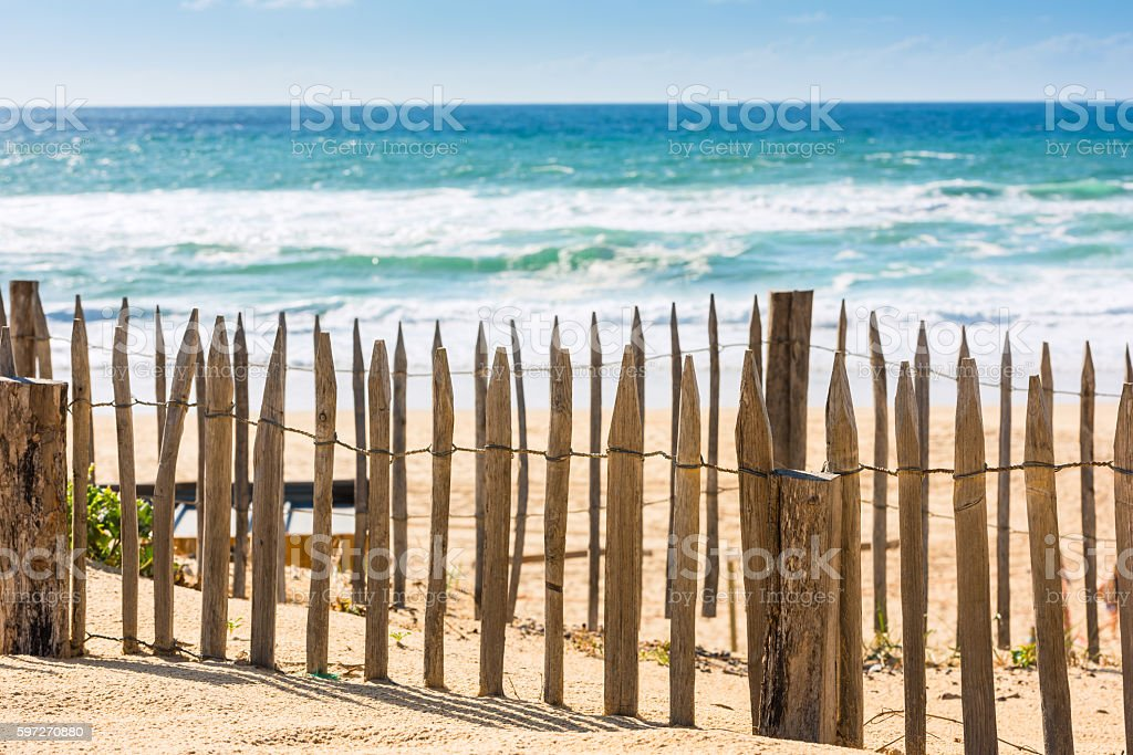 Wooden fence on an Atlantic beach in France royalty-free stock photo
