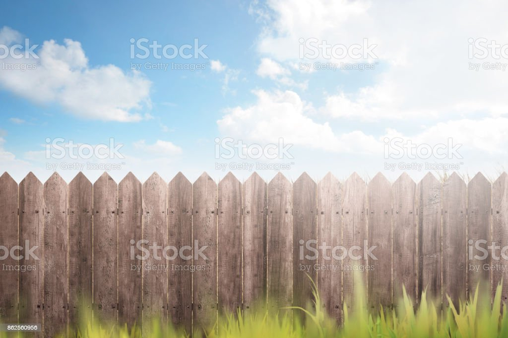Wooden fence on green garden stock photo