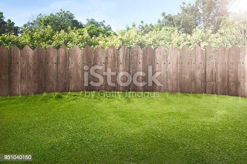 istock Wooden fence on green garden 931040150