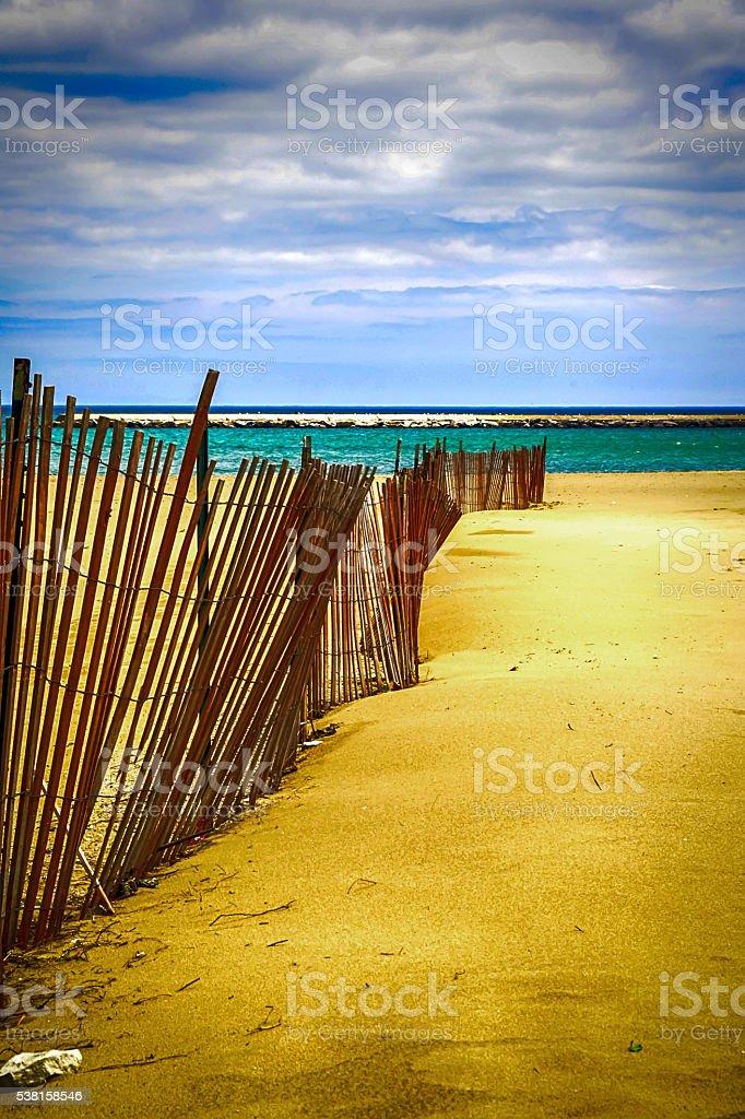 wooden fence on the beach at Kenosha Wisconsin stock photo