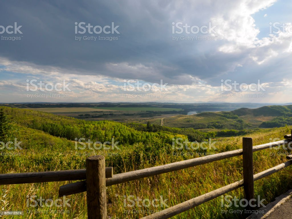 Wooden Fence overseeing the ranch as the rain clouds blow in stock photo