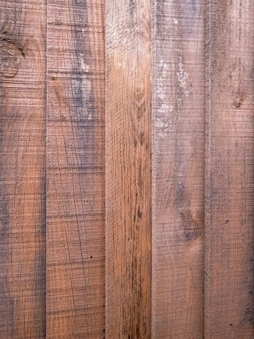 Close up of a brown wooden fence panel.
