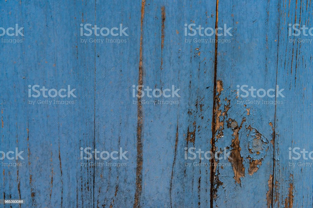 Wooden fence planks background painted in blue royalty-free stock photo