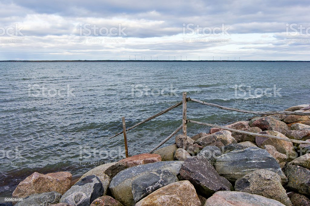 Wooden fence, sea and rocks, nature environment stock photo