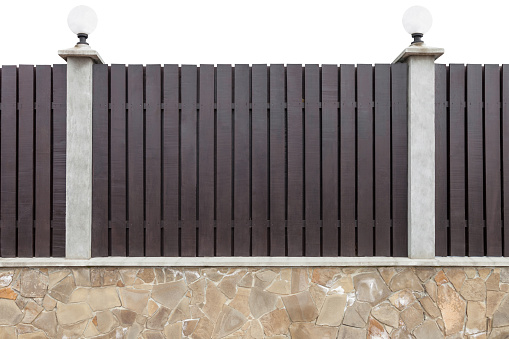 Wooden fence with concrete pillars