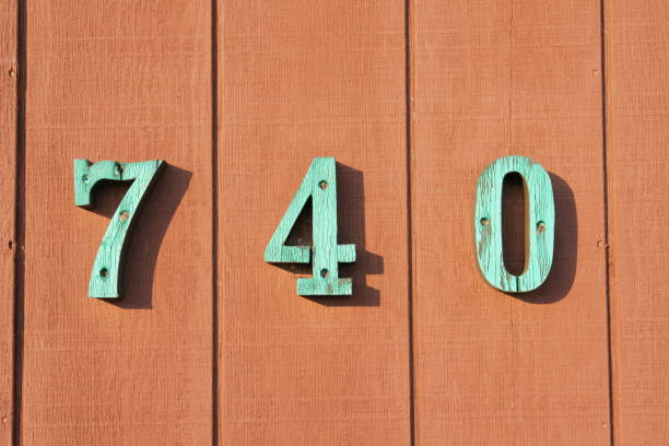 Wooden fence with house number 740 stock photo