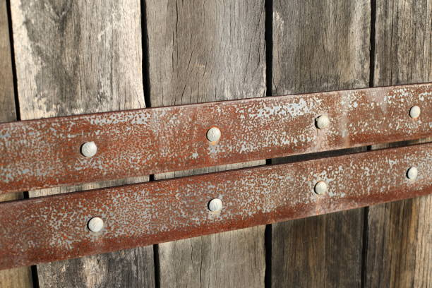 Wooden Fence with Iron Slats stock photo