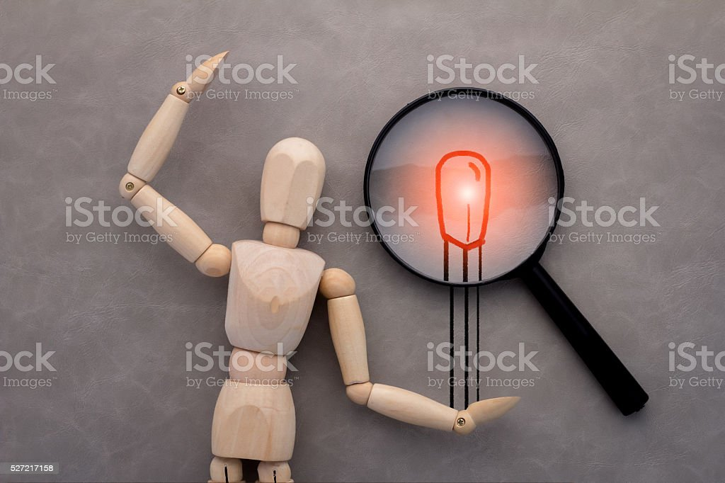 wooden figure and drawing of match and magnify.jpg wooden figure and drawing of match and magnify on grey background.jpg American Heart Association Stock Photo