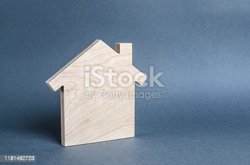 istock Wooden figure of a house. concept of buying and selling real estate, rent, investment. Home, Affordable housing, residential building. Construction buildings. Minimalism and copyspace 1181492723