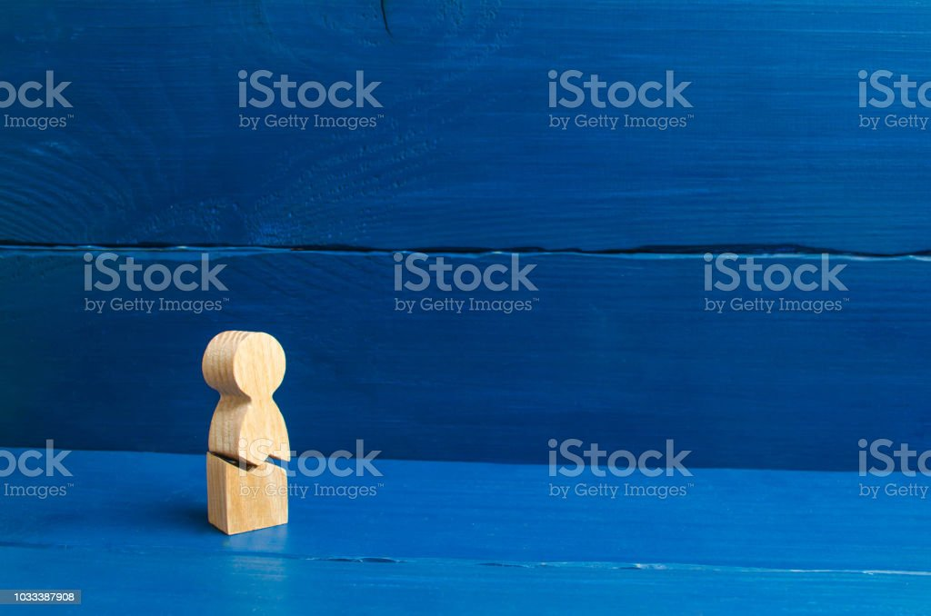 A Wooden Figure Of A Man With A Crack The Concept Of