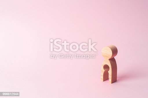 istock A wooden figure of a woman with a void inside in the shape of a child. The concept of the loss of child, abortion of pregnancy, miscarriage. Infertility in women. unhappy mother lost her child 996612544