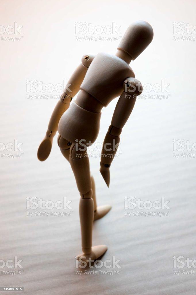 Wooden figure walking royalty-free stock photo