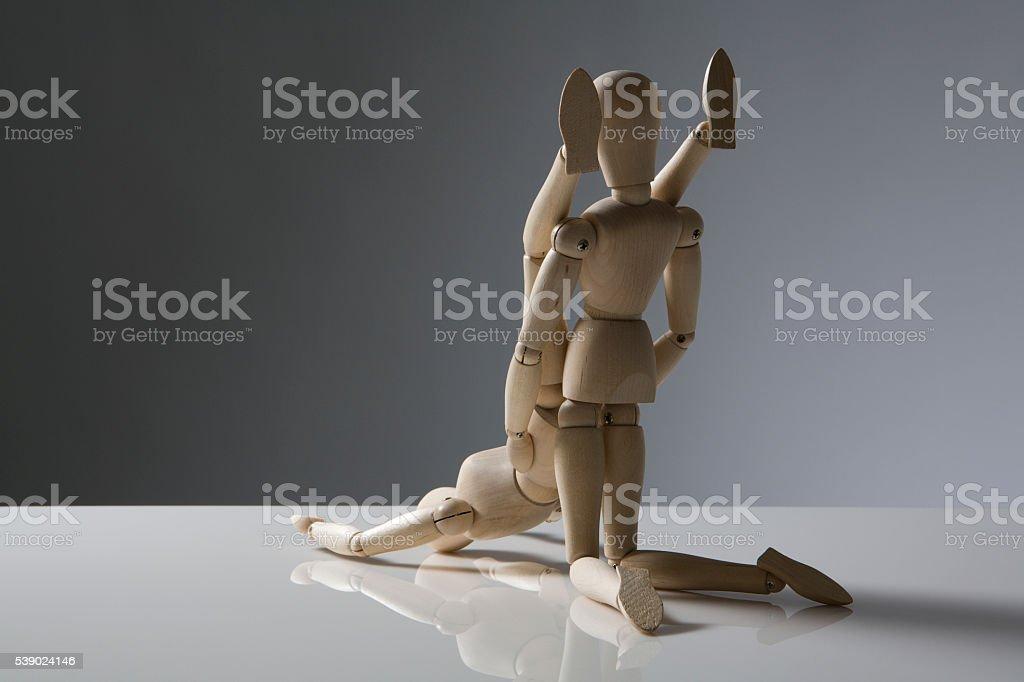 wooden figures having fun stock photo