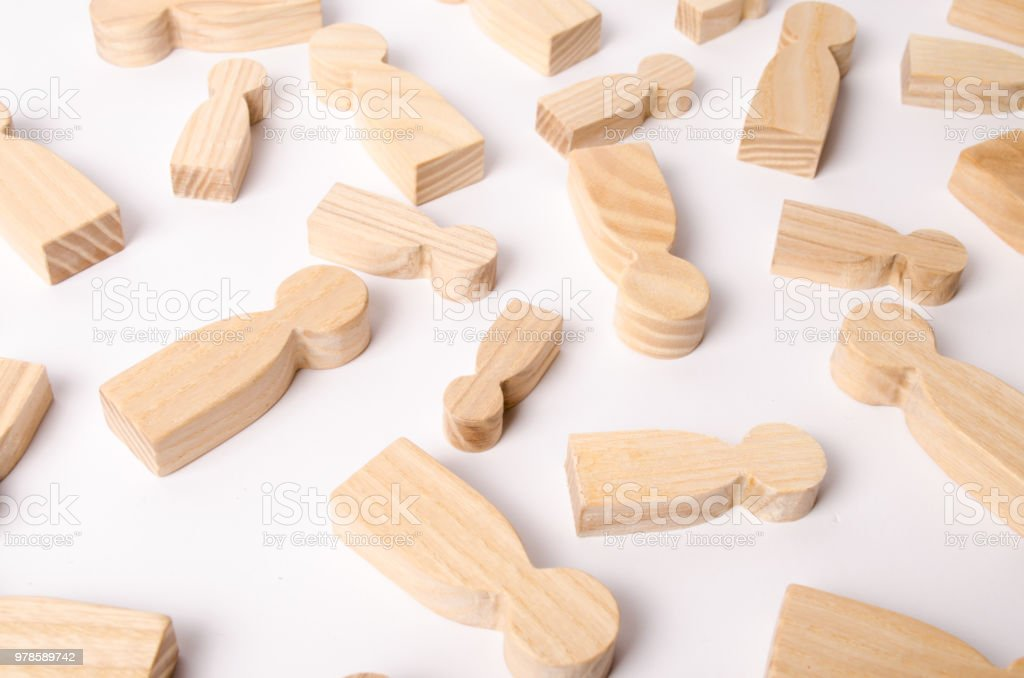 Wooden figures of people are lying on a white background. The concept of human resources management. Headhunters. Search for people to work. The search for the second half. Social network. Business stock photo