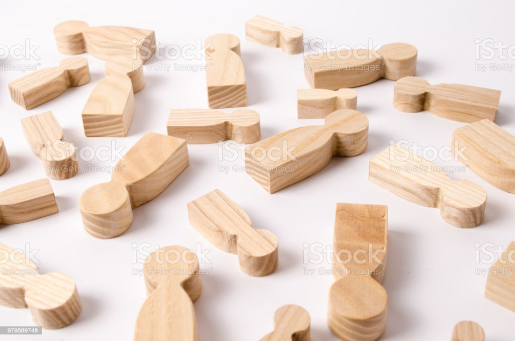 Wooden figures of people are lying on a white background. The search for the second half. Social network. Business. The concept of human resources management. Headhunters. Search for people to work. stock photo