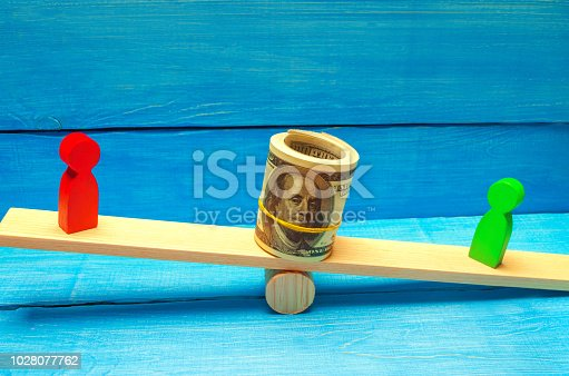 1018458132istockphoto wooden figures of people on scales and dollars between them. a dispute between two businessmen. trial. debt restructuring. wage arrears. protection of employee rights. court. Labor Law 1028077762